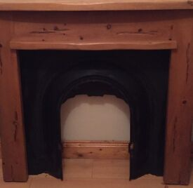 Mexican pine wooden surround with iron inset plus fire