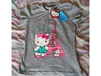 Brand new with Tags Girls Grey Hello Kitty T-Shirt Age 9-10 Paris Theme. Spring/Summer