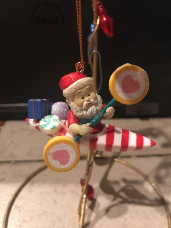 NON ENESCO/CHRISTMAS TRADITIONS CHRISTMAS ORNAMENT: SANTA ON CANDY KAYAK NEW