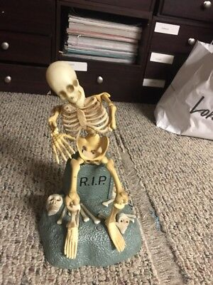 GEMMY Animated Dancing Skeleton On RIP Tomb Sings to Song