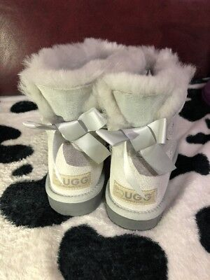 [ALL STOCK CLEARANCE] Ever UGG Women's Mini Back Bow Glitter Silver size US 7 (Uggs Shoes Clearance)