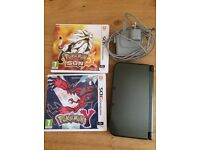 new nintendo 3ds xl in metallic black with games pokemon sun and pokemon y and wall charger