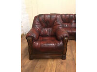 Leather 3 piece suite - settee and chairs. dark oxblood red. Wooden arms. good condition
