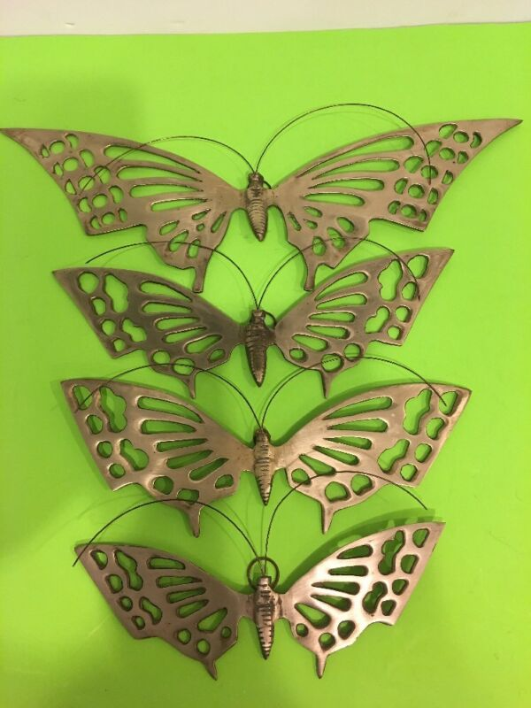 Vintage set of 4 brass wall hanging butterfly.