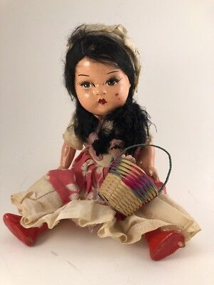 Vintage Compisition Doll 9 Inches With Basket Of Flowers