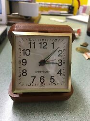 VINTAGE WESTCLOX TRAVEL ALARM CLOCK FOLDING LUMINOUS HANDS GOLD TONE BROWN CASE