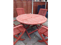 Round wooden garden table with 4 chairs!