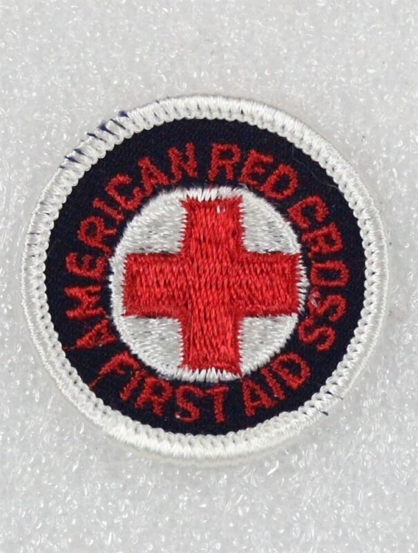 """Red Cross: First Aid patch, 1 5/8"""" round w/red letters on black, merrowed edge"""