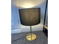 Gold lamp with black lampshade