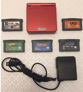 Gameboy Advance SP + original charger + 5 authentic Video Games