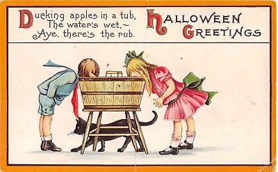 Black Halloween Apples (1914 Children Bobbing for Apples Black Cat Halloween Greetings postcard)