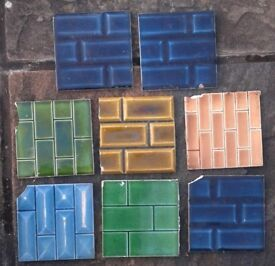8 (EIGHT) OldVitorian Embossed tiles, different colours, some are chipped (as seen) .£10.