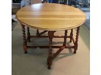 Folding Oak Dining Table with Barley cane Legs.