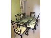 6 chairs and glass top dining table for sale