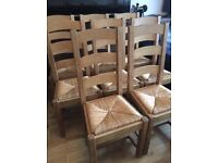 8 Lovely elegant solid wood chairs with rafia seats, very strong
