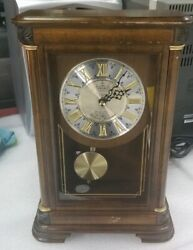 Seiko desk Clock with Pendulum Chiming gold Dial numbers. Quartz c battery.