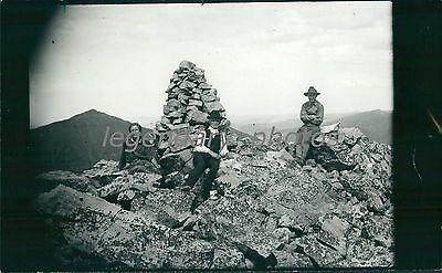 Photographer George Beard on Mt. Baldy with Monument