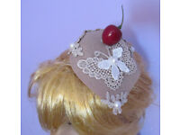 Handmade Ascot teardrop pearl cherry butterfly lace applique fascinator hat. Fastening is by 2 clips