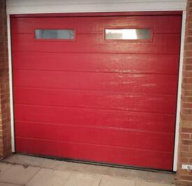 Garador sectional automatic garage door for sale in full working order.