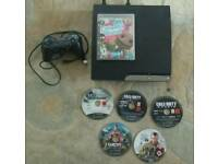Ps3 slim 320gb with 6 games for sale