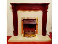 Fire surround hearth matching back and Dimplex real flame electric fire.
