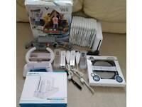 Wii + 12 games inc mario kart + family trainer mat