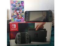 Nintendo Switch (Grey) + Mario Kart & Case