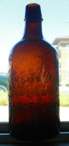 Nice Heavily Whittled Amber Star Spring Saratoga NY Mineral Spring Water Bottle