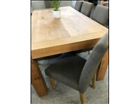 BRAND NEW HARVEYS OAK DINING SUITE WITH 6 MATCHING FABRIC CHAIRS