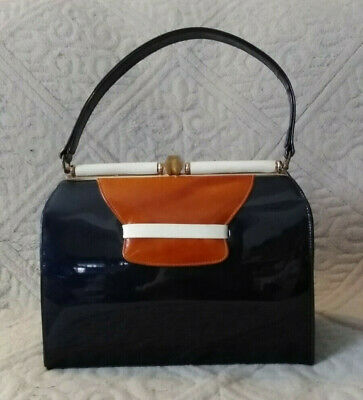 1950s Handbags, Purses, and Evening Bag Styles Vintage 1950s LEON OF CALIFORNIA Patented Leather Dark Blue Structured Purse $28.00 AT vintagedancer.com