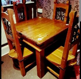 Solid wood dining table and vintage chairs