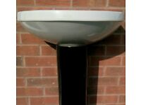 BLACK AND WHITE SINK AND PEDESTAL