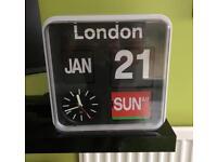 Habitat flap clock