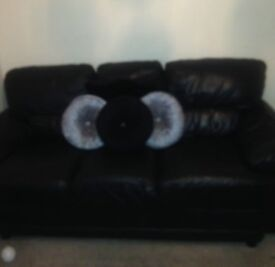 Black leather 3 seater and 1arm chair