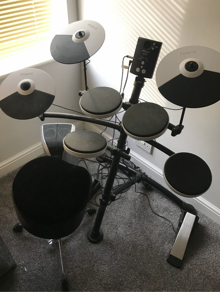 Roland electric drum kit, amp and luxury drum stool