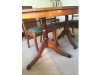 Oval Extending Table with 8 Chairs