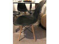 Four modern black chairs