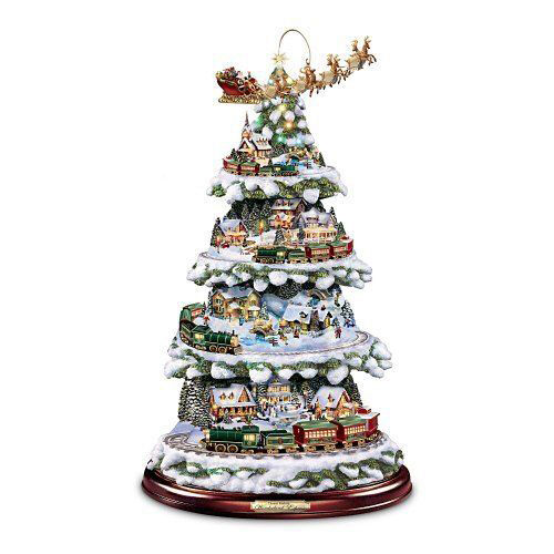thomas kinkades wonderland express animated christmas tree is a little different from the average artificial tree it is only 16 inches tall - Different Christmas Trees