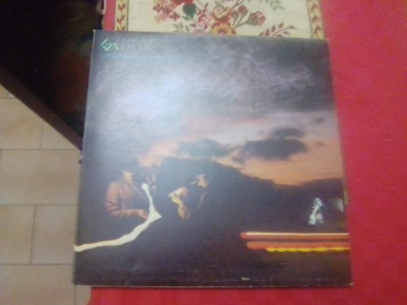 Genesis lp and then there were three uk 1978 come...
