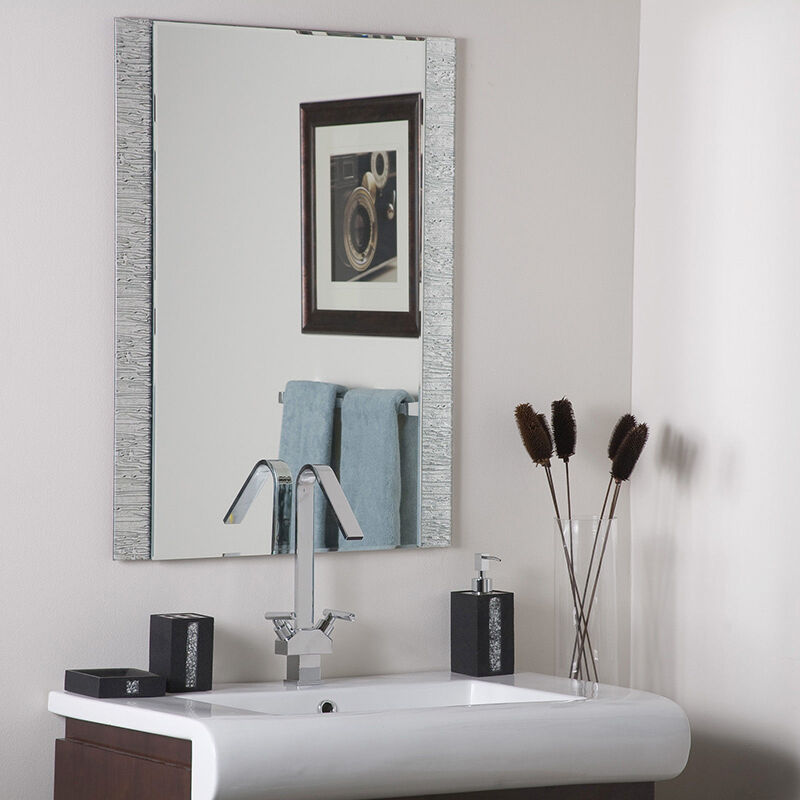 this frameless mirror from wonderland wall mounts so a homeowner can hang this mirror vertically or the made this mirror out of