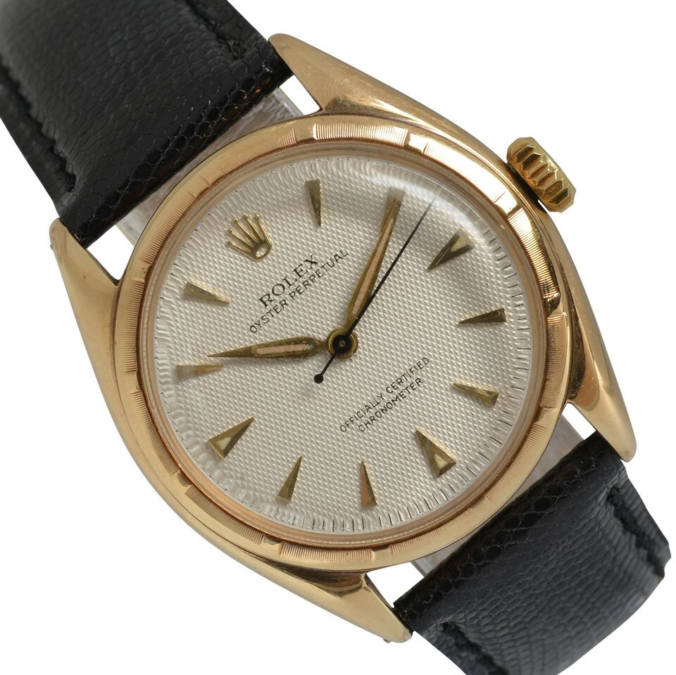 ROLEX Oyster Perpetual Bubbleback 6085 Honeycomb dial gold
