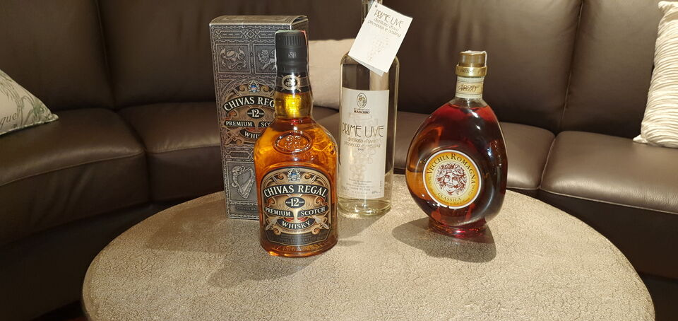 3 bottiglie vintage di whisky, grappa e brandy