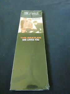 THE-BEATLES-SHE-LOVES-YOU-RARE-SEALED-USA-LONGBOX-CD