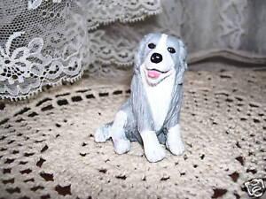 GRAY-WHITE-DOG-FIGURE-M-E-G-94