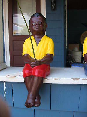 BLACK FISHING BOY RASTUS JR....CEMENT STATUE.. YARD ...