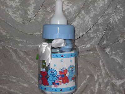 Sesame Street 10 Pc. Gift Set Baby Bank Bottle Bib