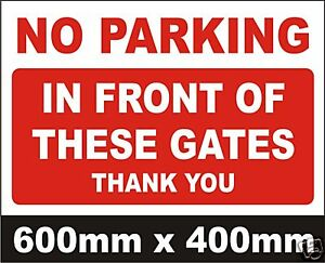 NO-PARKING-IN-FRONT-OF-THESE-GATES-SIGN-VERY-LARGE