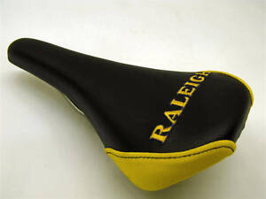 RALEIGH-EMBROIDERED-SADDLE-FOR-MOUNTAIN-BIKE-FIXIE-ANY-BIKE-BLACK-amp-YELLOW-NOS
