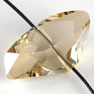 Genuine-SWAROVSKI-Crystal-FACETED-Galactic-BEAD-27x15mm-Golden-Shadow-5556