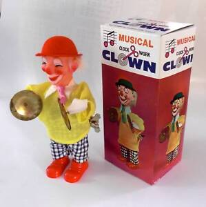 1980's Collectible Wind Up Toy Musical Clown with plate